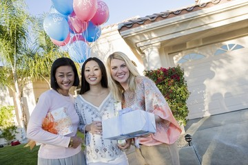Pregnant Asian Woman with Mother and Friend at a Baby Shower