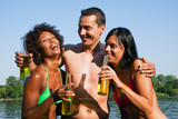 Group of friends drinking beer in swimwear poster