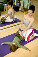 Young woman with child doing Pilates