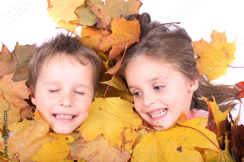 twins in autumn leaves