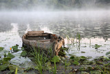 Foggy dawn on the river in August. poster