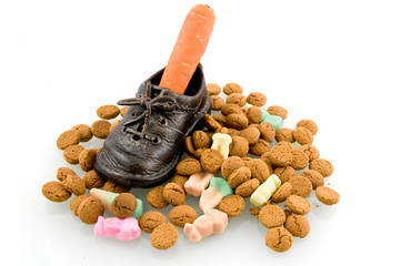 A shoe with carrot and Sinterklaas candy