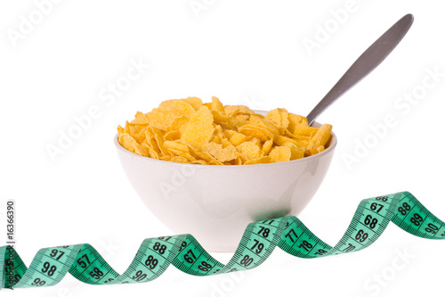 cornflakes in bowl and measuring tape