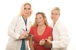 two doctors nurses in medical scrubs clothes with patient