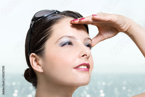 Woman searching through sunlight