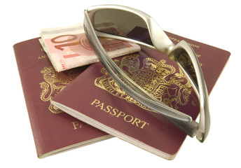 two passports with sun glasses and euro notes