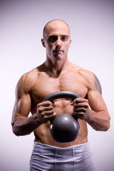 Man with kettlebells