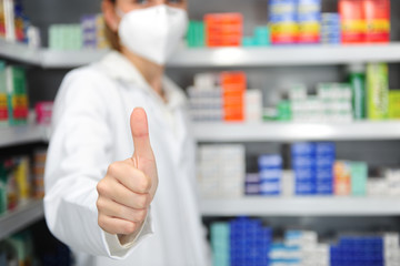 pharmacist with mask giving thumbs up