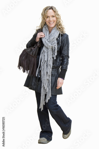 Smiling woman wearing leather coat and scarf