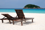 Quiet beach atmosphere with two chairs poster
