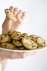 A woman holding a plate of cookies, close-up