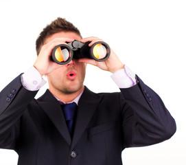 man looking through binoculars surprise