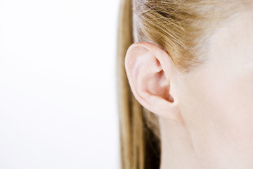 Close-up of a woman's ear, right side
