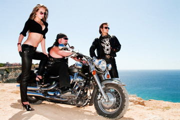 Two bikers with the girl and a motorcycle