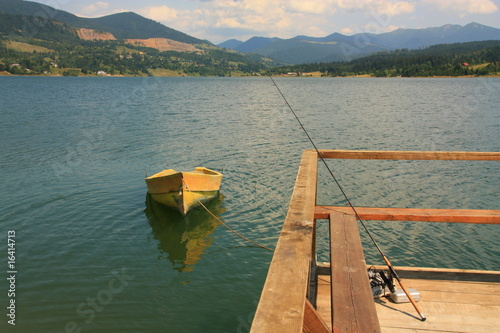 Yellow boat and fishing rod