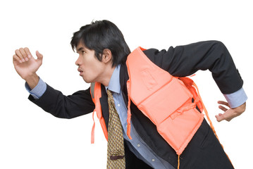 Businessman in life jacket escaping