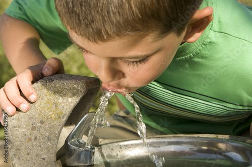 Boy drinking - 16423990