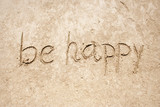 Be happy handwritten in sand for natural, symbol,tourism poster