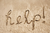Help handwritten in sand on a beach poster