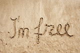 I`m free handwritten in sand for natural, symbol,tourism poster
