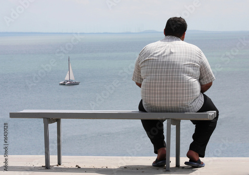 A man sitting on the bench