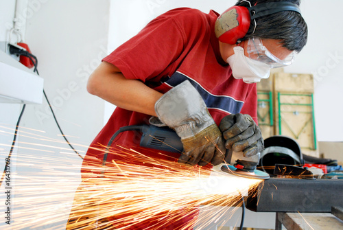 metal worker with a grinder and a lot of sparks