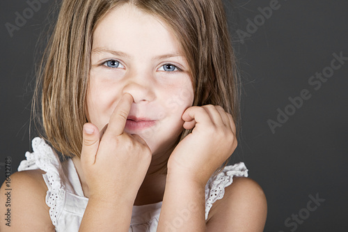 Shot of a Cute Blonde Child Picking her Nose
