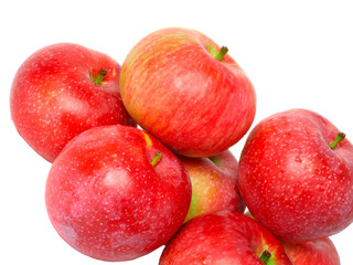 Fragmen of  ripe, red apples. Isolated on white