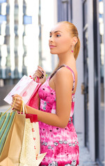 outdoor picture of attractive woman with shopping bags