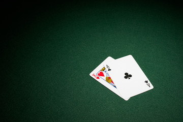 Blackjack hand on green baize table