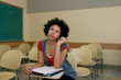 African American Student studying in classroom