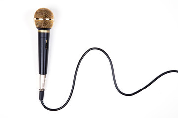 A dynamic microphone on white