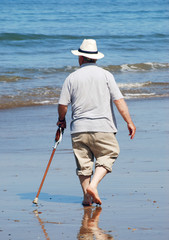 Senior walking on beach