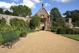 decorative entrance. garden scene. garden wall. bench