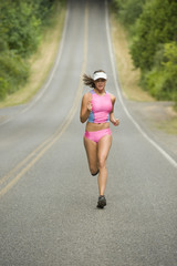 Attractive Female Runner on Country Road