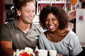 Mixed race couple in coffee house
