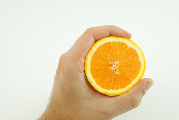 Hand with halved orange