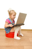 Little girl sitting on red potty with computer