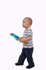 Small boy with toy standing