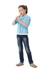 Pretty young girl playing recorder on white background