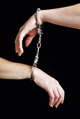 two hand shackled with handcuffs