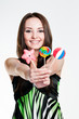 Smiling girl with lollipops