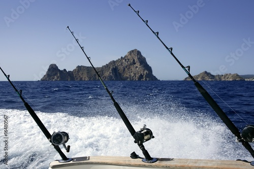 Fishing rod and reel on boat  in blue ocean