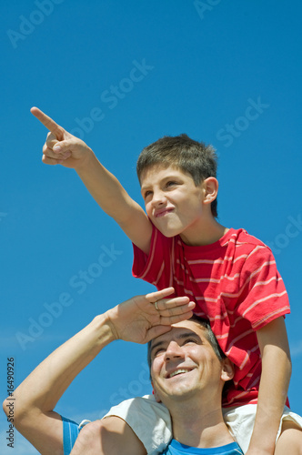 father and his son play outdoors