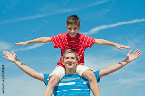 father and his son plays outdoors Poster