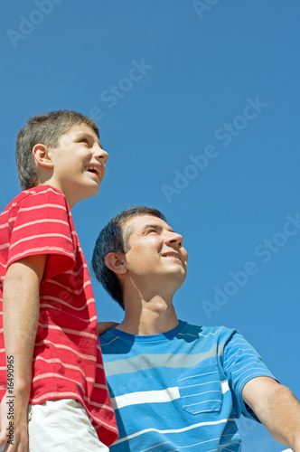 father and his son outdoors Poster