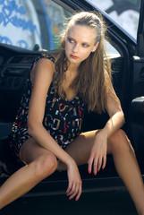 model in a car