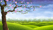 Blooming fairy-tale tree over colorful rolling landscape