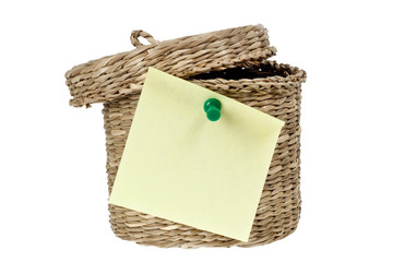 Basket with sticky note isolated on white background
