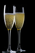Two glasses champagne on black closeup